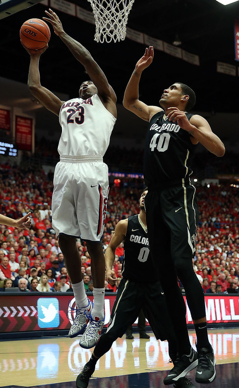 . Rondae Hollis-Jefferson #23 of the Arizona Wildcats attempts a shot past Josh Scott #40 of the Colorado Buffaloes during the first half of the college basketball game at McKale Center on January 23, 2014 in Tucson, Arizona.  (Photo by Christian Petersen/Getty Images)