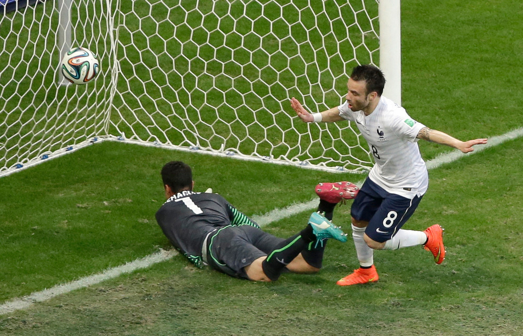 . France\'s Mathieu Valbuena, right, celebrates scoring his side\'s third goal past Switzerland\'s goalkeeper Diego Benaglio during the group E World Cup soccer match between Switzerland and France at the Arena Fonte Nova in Salvador, Brazil, Friday, June 20, 2014. (AP Photo/Sergei Grits)