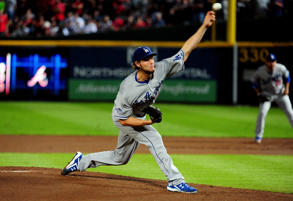 . ATLANTA, GA - OCTOBER 03:  Clayton Kershaw #22 of the Los Angeles Dodgers pitches against the Atlanta Braves during Game One of the National League Division Series at Turner Field on October 3, 2013 in Atlanta, Georgia.  (Photo by Scott Cunningham/Getty Images)