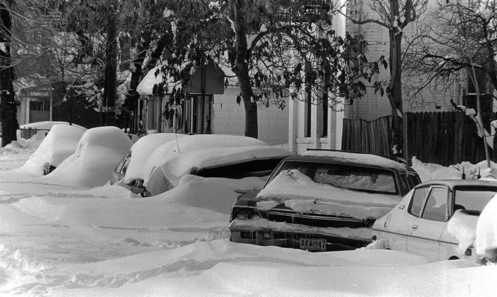 . Cars sit buried along the street after the Blizzard of \'82. Denver Post Library Archive