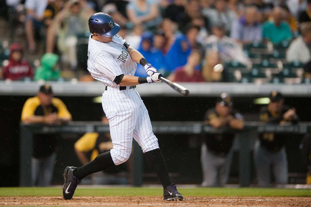 . Drew Stubbs #13 of the Colorado Rockies hits a lead off home run in the fourth inning of a game against the Pittsburgh Pirates at Coors Field on July 26, 2014 in Denver, Colorado.  (Photo by Dustin Bradford/Getty Images)