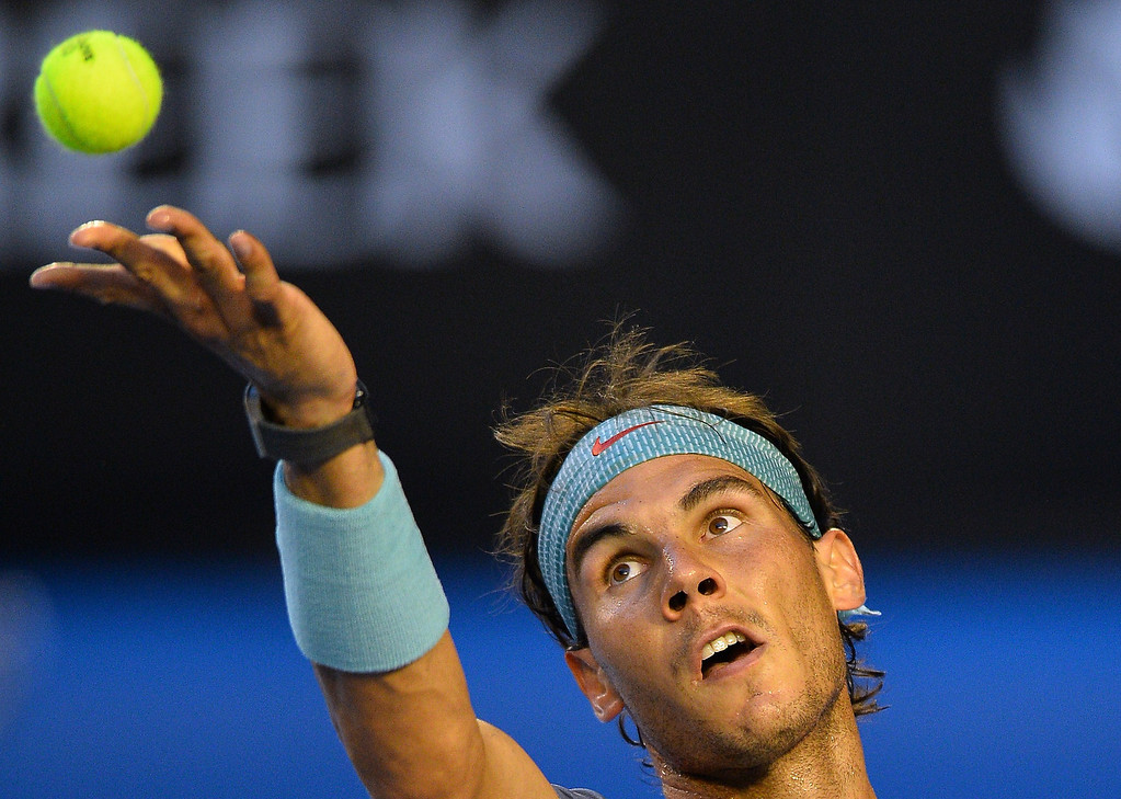. Spain\'s Rafael Nadal serves against Switzerland\'s Stanislas Wawrinka during the men\'s singles final on day 14 of the 2014 Australian Open tennis tournament in Melbourne on January 26, 2014.    SAEED KHAN/AFP/Getty Images