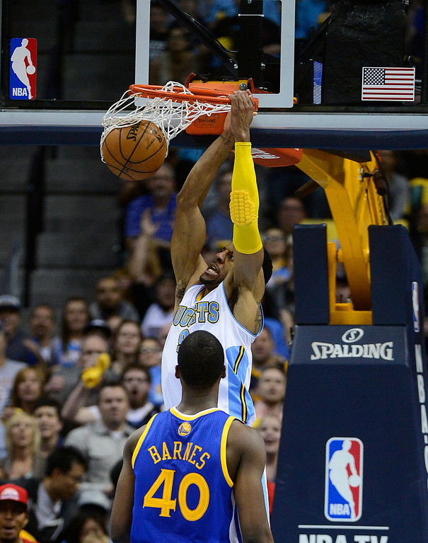 . Denver Nuggets shooting guard Andre Iguodala (9) goes up for a dunk in the second quarter. The Denver Nuggets took on the Golden State Warriors in Game 5 of the Western Conference First Round Series at the Pepsi Center in Denver, Colo. on April 30, 2013. (Photo by AAron Ontiveroz/The Denver Post)