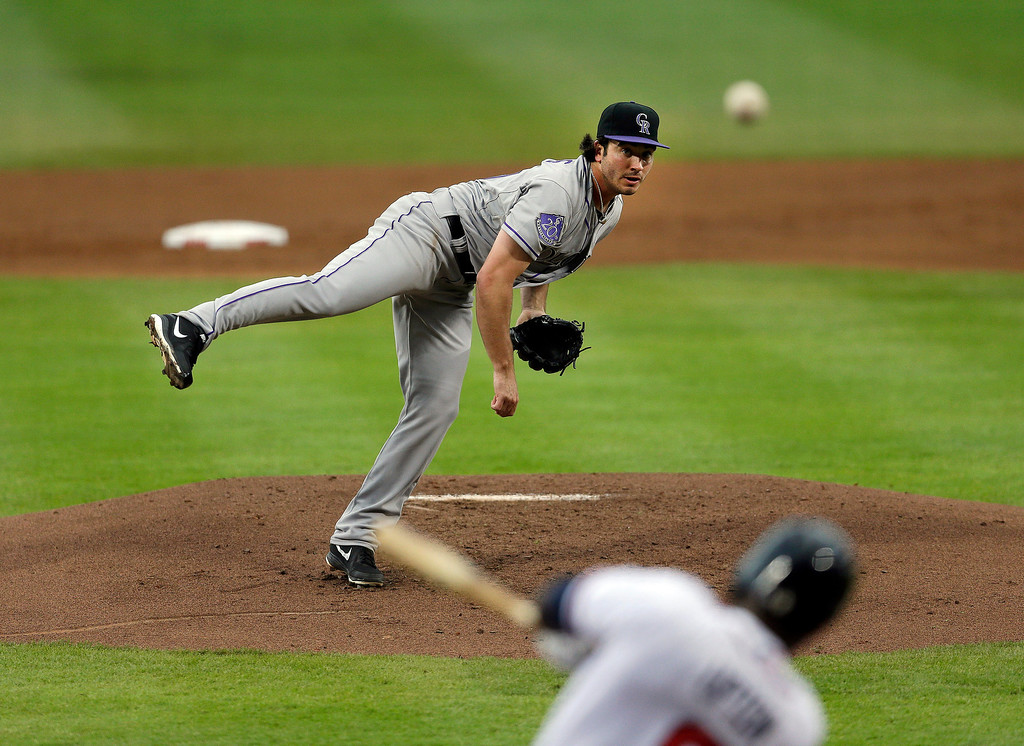 . Atlanta Braves left fielder Justin Upton (8) hits a two-run home run off Colorado Rockies starter rookie Chad Bettis in the first inning of a baseball game in Atlanta, Thursday, Aug. 1, 2013. Bettis was making his major league debut. (AP Photo/John Bazemore)