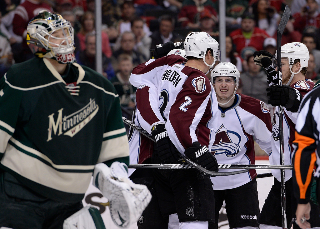 . Colorado Avalanche defenseman Nick Holden (2) celebrates his goal on Minnesota Wild goalie Darcy Kuemper (35) with Colorado Avalanche center Matt Duchene (9) during the second period April 28, 2014 in Game 6 of the Stanley Cup Playoffs at Xcel Energy Center.  (Photo by John Leyba/The Denver Post)