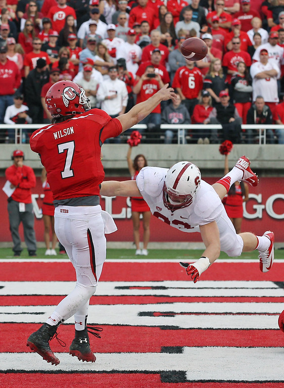 . Utah quarterback Travis Wilson (7) passes the ball as Stanford linebacker Trent Murphy, right, dives for him during the second half of an NCAA college football game on Saturday, Oct. 12, 2013, in Salt Lake City. (AP Photo/Rick Bowmer)