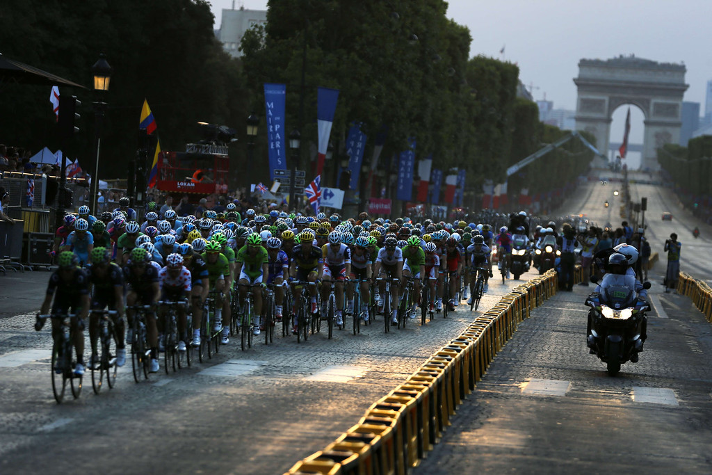 . The pack rides on the Champs Elysees avenue during the 133.5 km twenty-first and last stage of the 100th edition of the Tour de France cycling race on July 21, 2013 between Versailles and Paris.  JEFF PACHOUD/AFP/Getty Images
