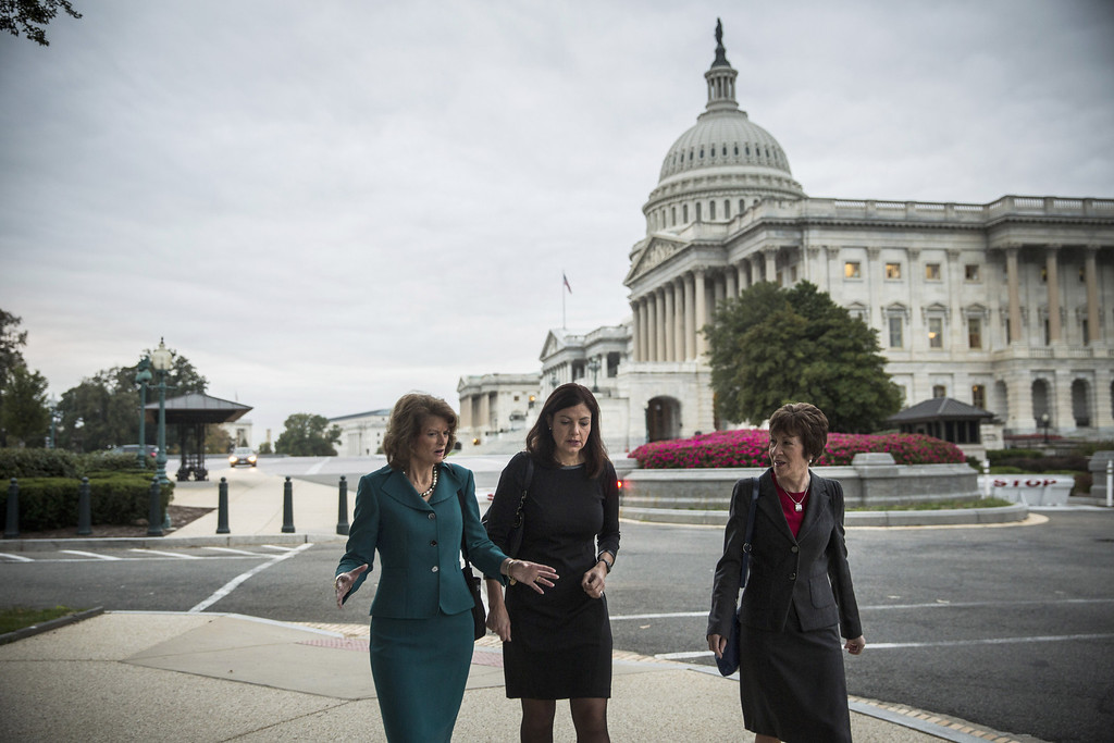 . WASHINGTON, DC - OCTOBER 16:  (L-R) Sen. Lisa Murkowski (R-AK), Sen. Kelly Ayotte (R-NH) and Sen. Susan Collins (R-ME) walk past the Capitol Building after praying with a group of religious leaders and also appearing on national television on the morning of October 16, 2013 in Washington, DC. Today marks the 16th day of the government shutdown and the last day to find a solution before the government could potentially begin defaulting on debts.  (Photo by Andrew Burton/Getty Images)