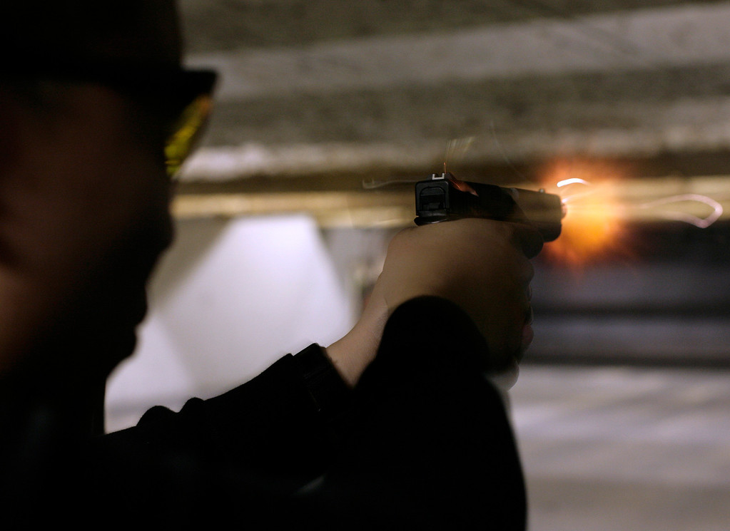 . An unidentified man fires his Glock 9 mm pistol at the Maryland Small Arms Range in Upper Marlboro, Maryland, just outside Washington, April 17, 2007. REUTERS/Yuri Gripas