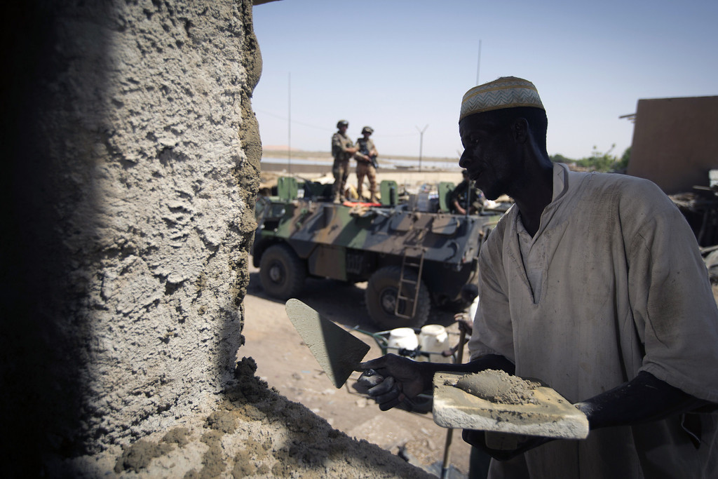 . A Malian works on the building of the new market in Gao port on April 4, 2013 .The United Nations expressed concern over reprisal attacks against ethnic Tuaregs and Arabs in Mali, where a French-led intervention recently routed Islamist rebels. JOEL SAGET/AFP/Getty Images