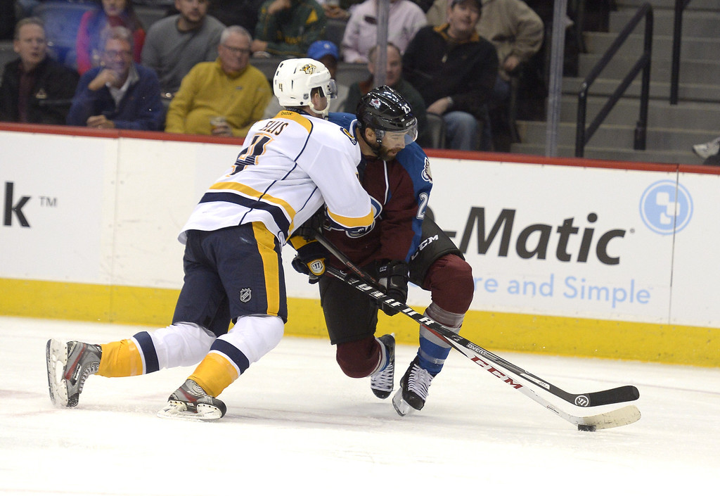 . The Colorado Avalanche Maxime Talbot (25) gets pushed off the puck by Nashiville Predators Ryan Ellis (4) duirng the first period November 6, 2013 at Pepsi Center. (Photo by John Leyba/The Denver Post)