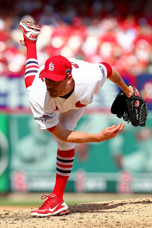 . ST LOUIS, MO - OCTOBER 04:  John Axford #34 of the St. Louis Cardinals pitches in the sixth inning against the Pittsburgh Pirates during Game Two of the National League Division Series at Busch Stadium on October 4, 2013 in St Louis, Missouri.  (Photo by Dilip Vishwanat/Getty Images)