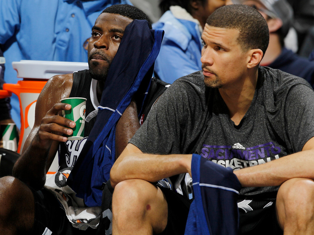 . Sacramento Kings guards Tyreke Evans, left, and Francisco Garcia, of the Dominican Republic, sit on the bench and look on in the fourth quarter of the Denver Nuggets\' 121-93 victory over the Kings in an NBA basketball game in Denver on Saturday, Jan. 26, 2013. (AP Photo/David Zalubowski)