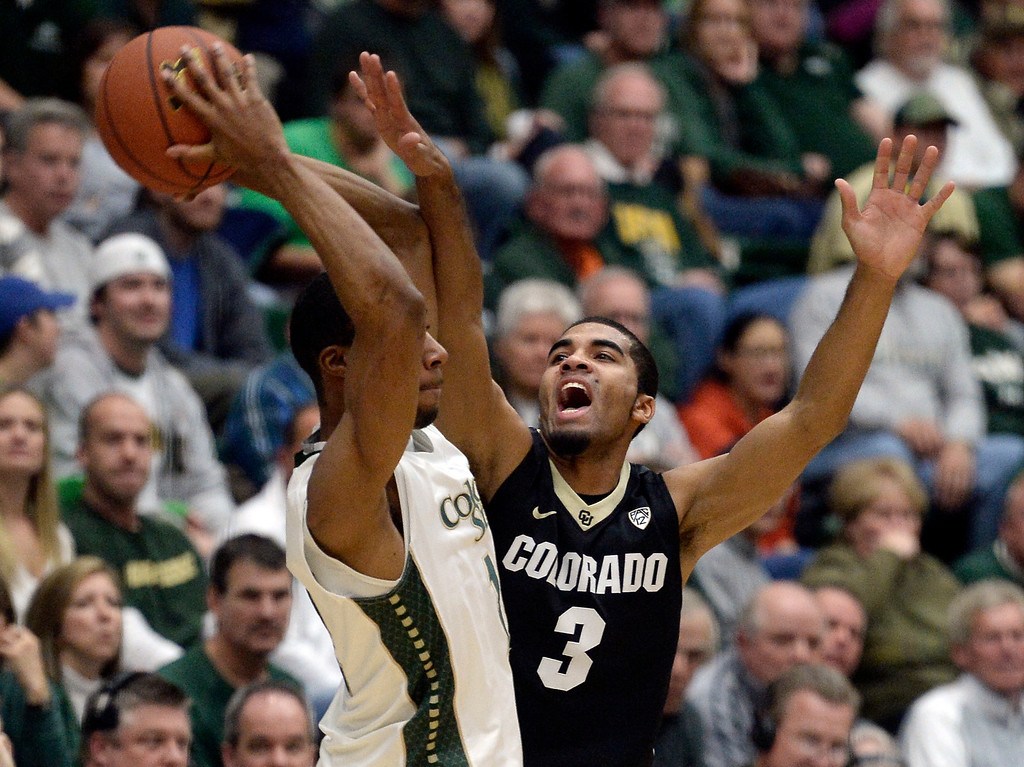 . Colorado\'s Xavier Talton plays defense on Carlton Hurst during an NCAA game against CSU on Tuesday, Dec. 3, 2013, at the Moby Arena in Fort Collins.