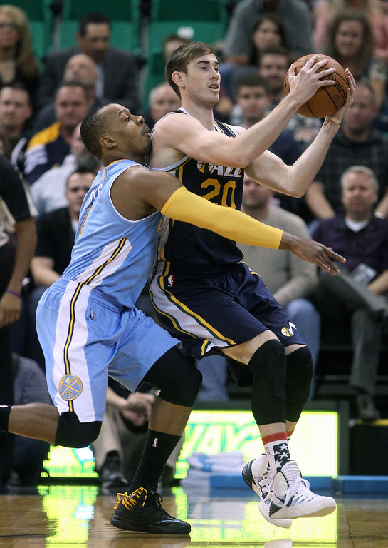 . Denver Nuggets\' Randy Foye, left, defends against Utah Jazz\'s Gordon Hayward (20) in the first quarter during an NBA basketball game Monday, Nov. 11, 2013, in Salt Lake City.  (AP Photo/Rick Bowmer)