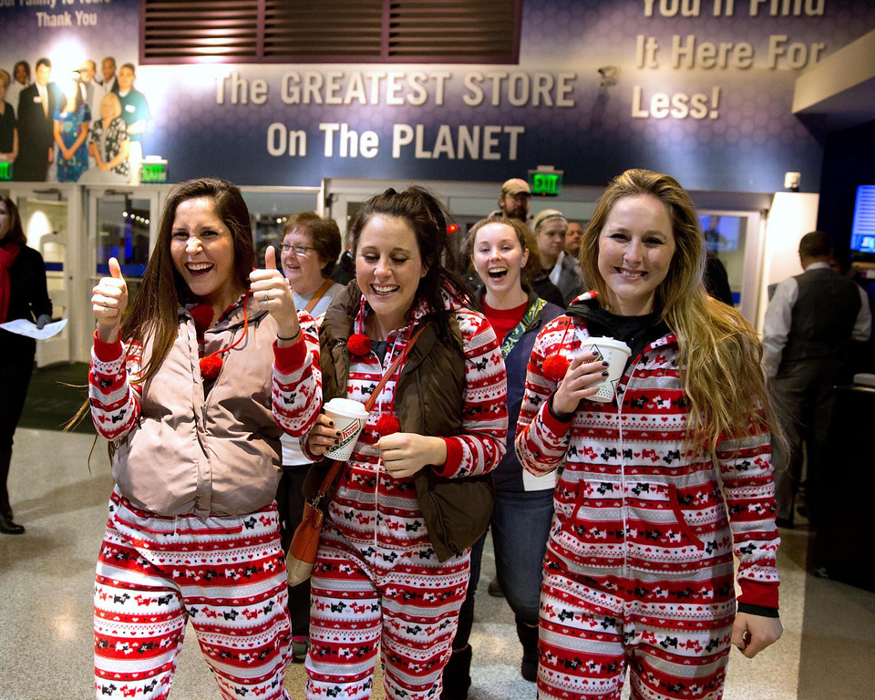 . Sisters, from left, Sophia, Meghan and Hanna Sonenberg of Lincoln Neb., make their way into the Nebraska Furniture Mart in Omaha Neb.,  Friday, Nov. 29, 2013. Black Friday, the day after Thanksgiving, is the nation\'s biggest shopping day of the year. (AP Photo/The Omaha World-Herald/Jm Burnett)