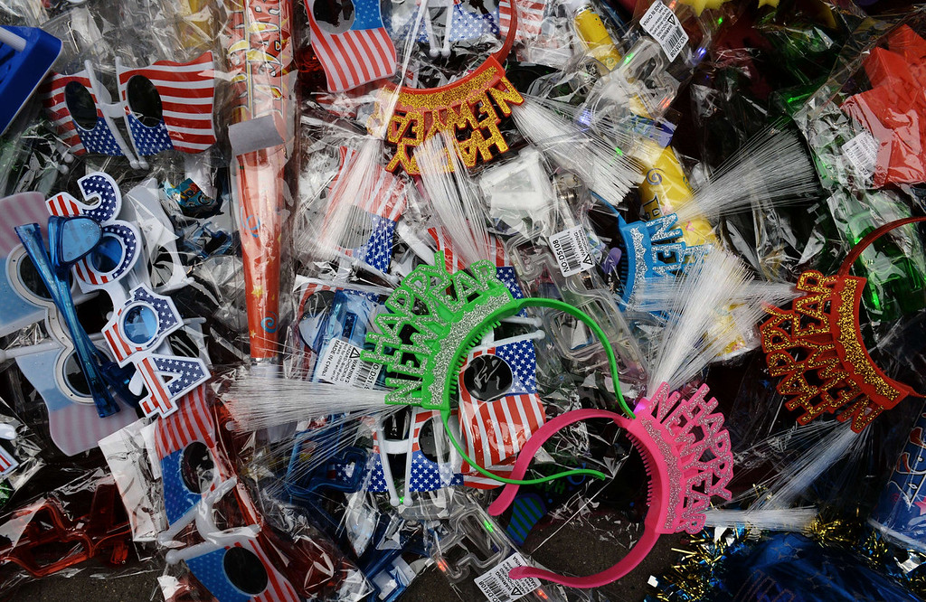 . Party items on sale for celebrations on December 31, 2013 in Times Square in New York. Cold temperatures are forecast as the crowd is expected to reach one million to watch the New Year ball to drop.    DON EMMERT/AFP/Getty Images