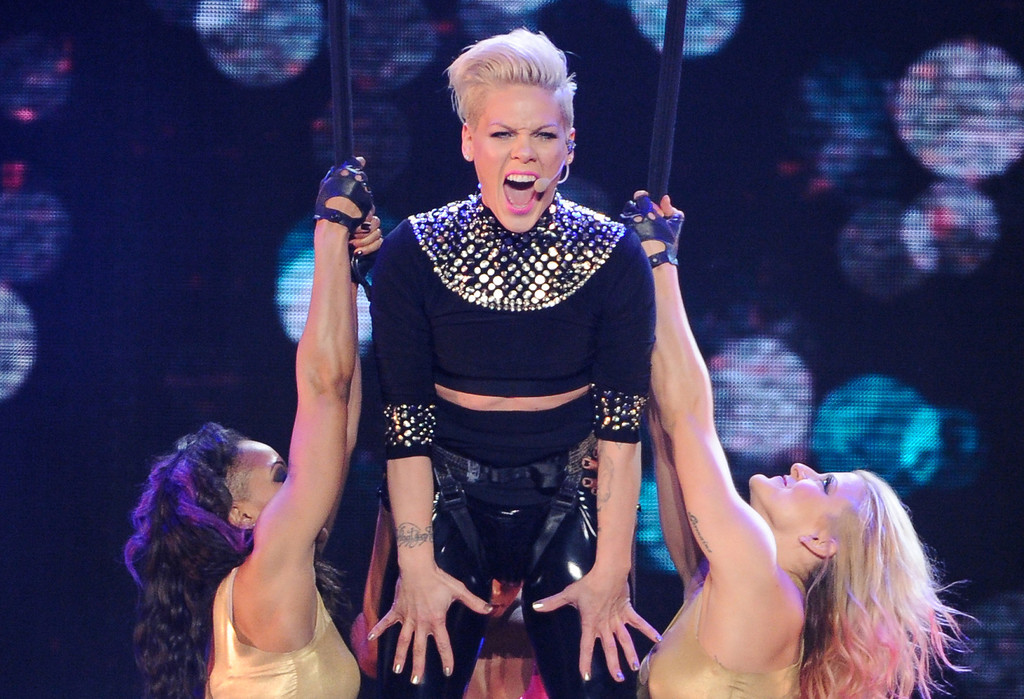 ". FILE - This March 22, 2013 file photo shows singer Pink during her ""The Truth About Love\"" tour at Madison Square Garden in New York. Pink\'s \""Just Give Me a Reason (feat. Nate Ruess),\"" is the top song on  iTunes\' Official Music Charts for the week ending April 15, 2013. (Photo by Evan Agostini/Invision/AP, file)"