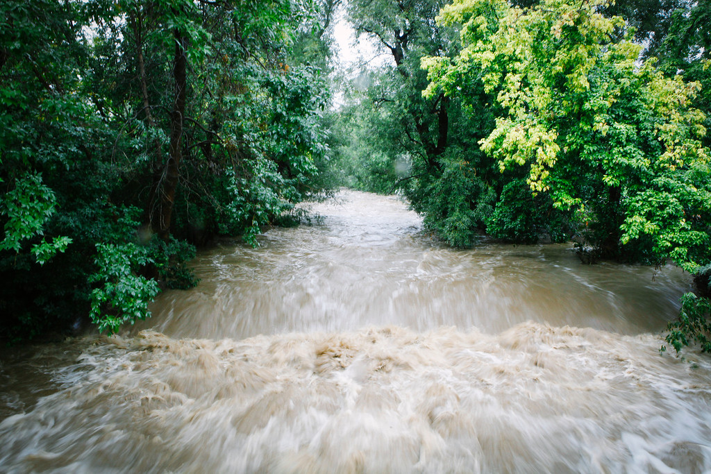 . BOULDER, CO - SEPTEMBER 12: Boulder Creek swells in size after three days of heavy rainfall September 12, 2013 in Boulder, Colorado. An estimated 6-10 inches of rain fell in 12-18 hours and more is expected throughout the day. Flash flood sirens warned people to stay away from Boulder Creek and seek higher ground.  (Photo by Dana Romanoff/Getty Images)