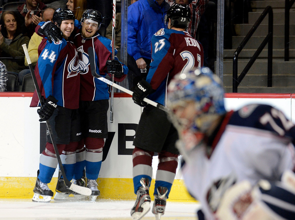 . DENVER, CO. - JANUARY 24: Colorado Avalanche center John Mitchell (7) celebrates his third period goal with Colorado Avalanche defenseman Ryan Wilson (44) and Colorado Avalanche right wing Milan Hejduk (23) as Columbus Blue Jackets goalie Sergei Bobrovsky (72) kneels dejected January 24, 2013 at Pepsi Center. The Colorado Avalanche defeat the Columbus Blue Jackets 4-0 at Pepsi Center.  (Photo By John Leyba / The Denver Post)
