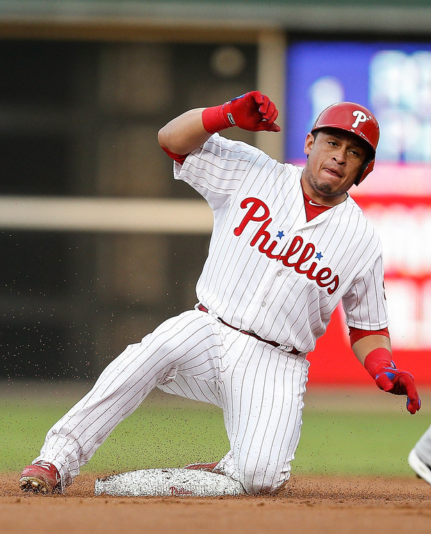 . Carlos Ruiz #51 of the Philadelphia Phillies gets up after safely sliding into second in the first inning of the game against the Colorado Rockies  at Citizens Bank Park on August 19, 2013 in Philadelphia, Pennsylvania. (Photo by Brian Garfinkel/Getty Images)