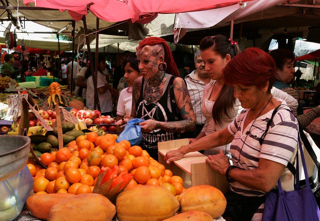 . Maria Jose Cristerna shops at a farmer\'s market in Guadalajara February 29, 2012.  REUTERS/Alejandro Acosta