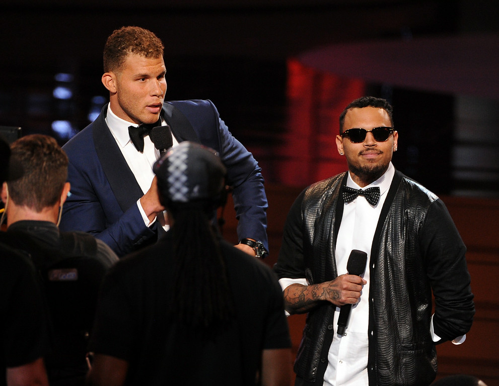 . LOS ANGELES, CA - JULY 16:  NBA player Blake Griffin (L) and singer Chris Brown speak onstage during the 2014 ESPYS at Nokia Theatre L.A. Live on July 16, 2014 in Los Angeles, California.  (Photo by Kevin Winter/Getty Images)