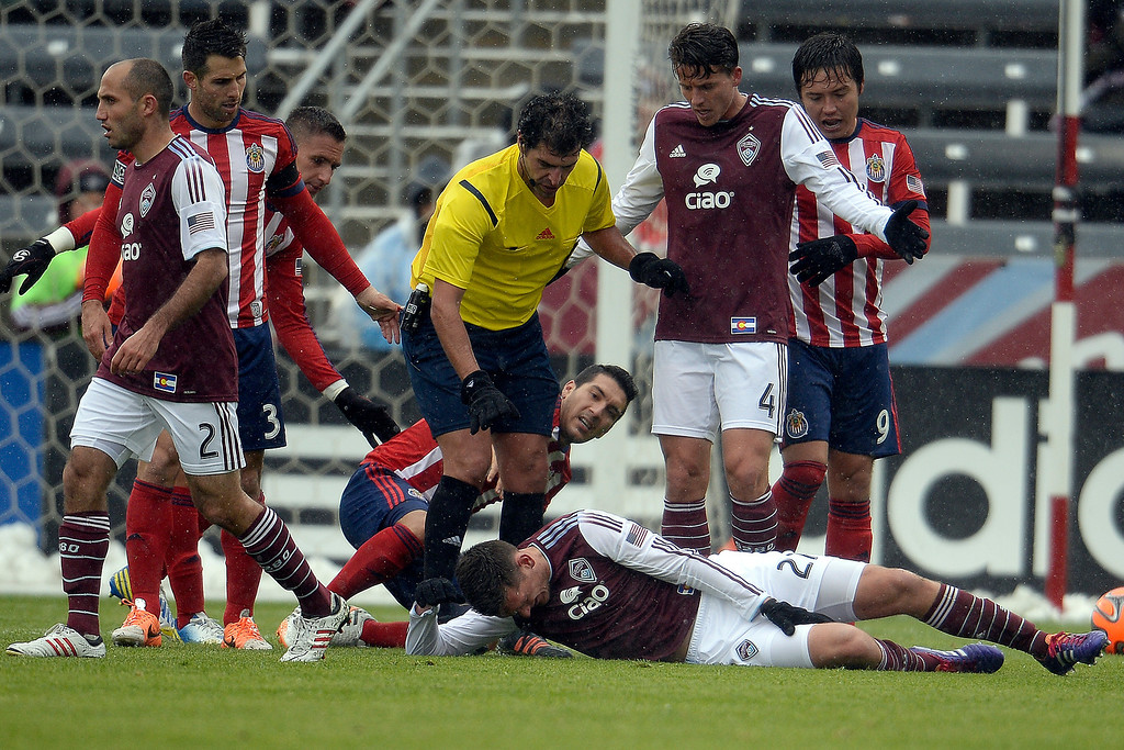 . Shane O\'Neill (27) of Colorado Rapids holds his leg after taking contact against Chivas USA during the second half. Chivas USA defeated the Colorado Rapids 3-1 on Sunday, May 11, 2014. (Photo by AAron Ontiveroz/The Denver Post)