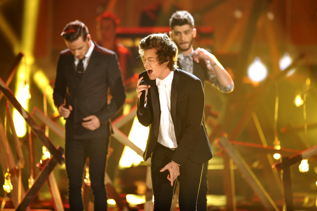 . Harry Styles of the musical group One Direction performs on stage at the American Music Awards at the Nokia Theatre L.A. Live on Sunday, Nov. 24, 2013, in Los Angeles. (Photo by John Shearer/Invision/AP)