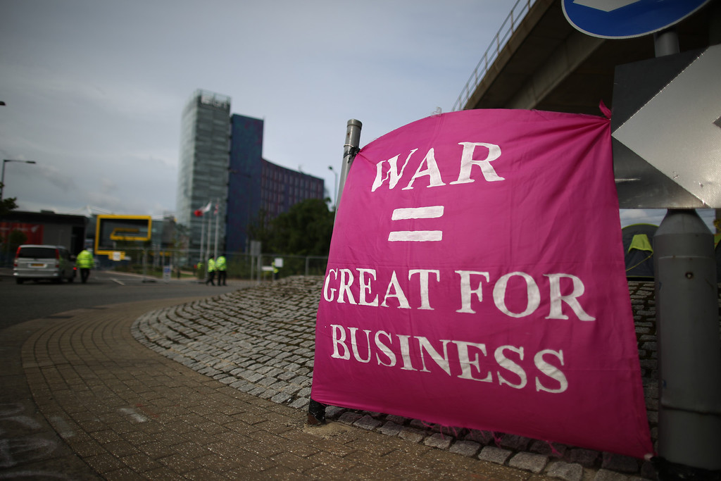. A peace protestor\'s banner hangs outside the Defense and Security Exhibition on September 10, 2013 in London, England.   (Photo by Peter Macdiarmid/Getty Images)
