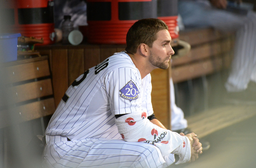 . DENVER, CO. - July 03: Tyler Chatwood of Colorado Rockies(32) is in dugout in the 4th inning of the game against Los Angeles Dodgers at Coors Field. Denver, Colorado. July 3, 2013. Chatwood pitched 5 innings.(Photo By Hyoung Chang/The Denver Post)