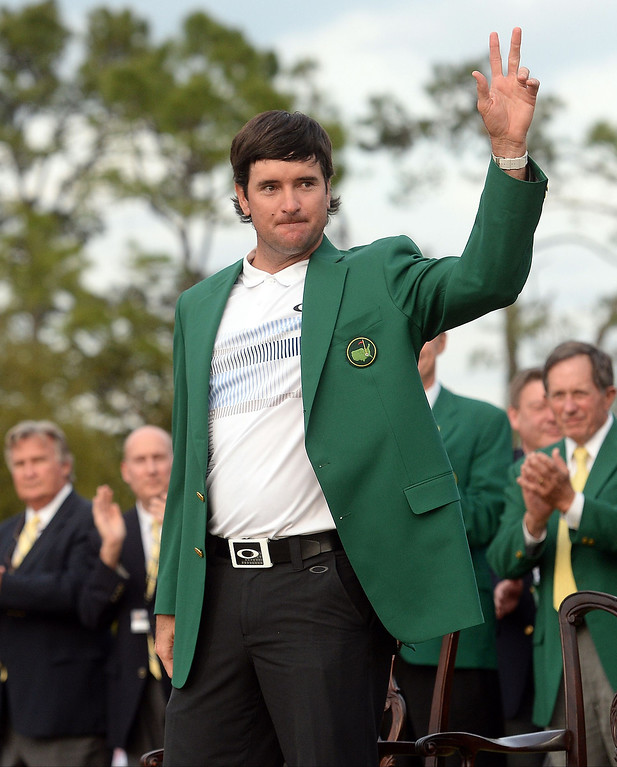 . Bubba Watson of the US waves after wearing his Green Jacket during a ceremony at the end of the 78th Masters Golf Tournament at Augusta National Golf Club on April 13, 2014 in Augusta, Georgia. Watson won his second Masters finishing 8-under par.   EMMANUEL DUNAND/AFP/Getty Images