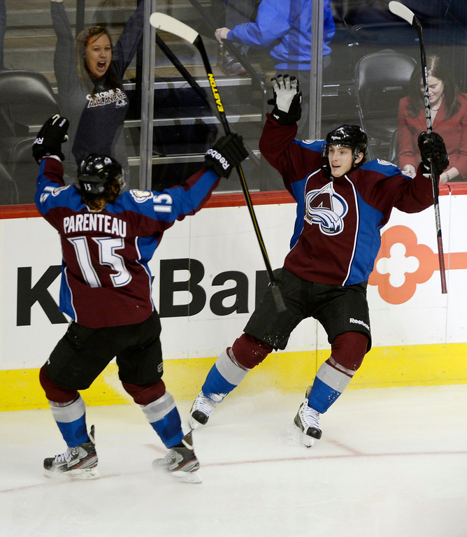 . DENVER, CO. - FEBRUARY 11: Matt Duchene (9) of the Colorado Avalanche celebrates his goal with PA Parenteau (15) after scoring on G Mike Smith (41) of the Phoenix Coyotes February 11, 2013 at Pepsi Center. (Photo By John Leyba/The Denver Post)