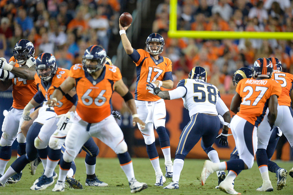 . DENVER, CO. - AUGUST 17: Denver Broncos quarterback Brock Osweiler (17) throws a pass up the middle during the third quarter against the St. Louis Rams August 24, 2013 at Sports Authority Field at Mile High. (Photo By John Leyba/The Denver Post)