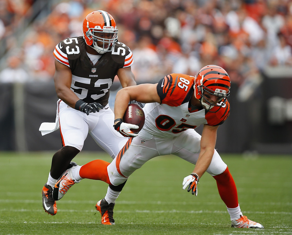 . CLEVELAND, OH - SEPTEMBER 29:  Tight end Tyler Eifert #85 of the Cincinnati Bengals is hit by linebacker Craig Robertson #53 of the Cleveland Browns at FirstEnergy Stadium on September 29, 2013 in Cleveland, Ohio.  (Photo by Matt Sullivan/Getty Images)