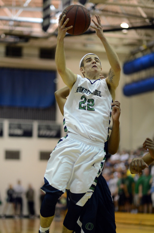 . HIGHLANDS RANCH, CO. - MARCH 02: Hunter O\'Neill of ThunderRidge High School is in action during the 2nd round of 5A playoff game against Overland High School at ThunderRidge High School. March 2, 2013. Highlands Ranch , Colorado. ThunderRidge won 67-57. (Photo By Hyoung Chang/The Denver Post)