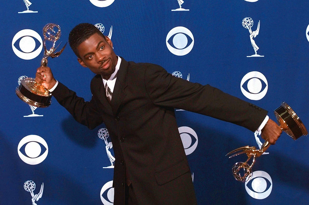 ". Chris Rock clowns around holding his awards for outstanding writing for a variety or music program and outstanding variety music or comedy special for ""Chris Rock:Bring the Pain\"" at the 49th Annual Primetime Emmy Awards, Sunday Sept. 14, 1997 in Pasadena, Calif. (AP Photo/Kevork Djansezian)"