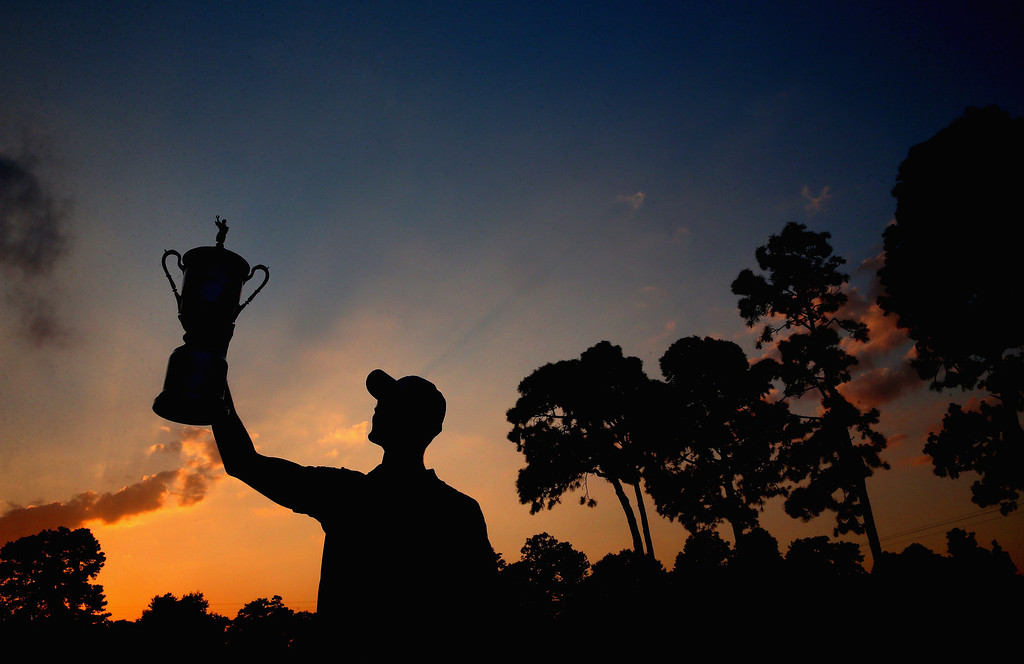 . Martin Kaymer of Germany celebrates with the trophy after his eight-stroke victory during the final round of the 114th U.S. Open at Pinehurst Resort & Country Club, Course No. 2 on June 15, 2014 in Pinehurst, North Carolina.  (Photo by Andrew Redington/Getty Images)