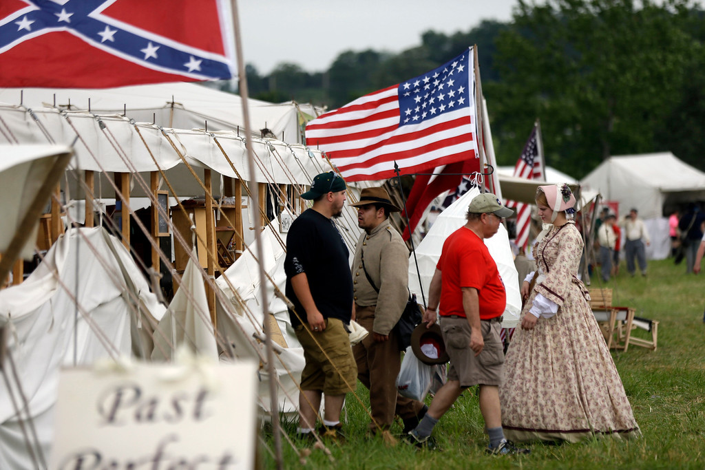 . Shoppers walk in and out of tents at Bushey Farm during ongoing activities commemorating the 150th anniversary of the Battle of Gettysburg, Thursday, June 27, 2013, in Gettysburg, Pa.  Union forces turned away a Confederate advance in the pivotal battle of the Civil War fought July 1-3, 1863, which was also the warís bloodiest conflict with more than 51,000 casualties. (AP Photo/Matt Rourke)