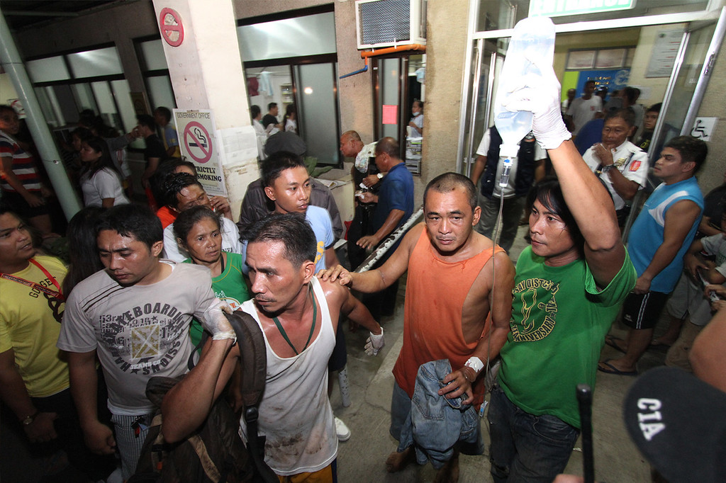 . A survivor goes out of a hospital in Cebu, central Philippines late Friday Aug. 16, 2013. Passenger ferry MV Thomas Aquinas with nearly 700 people aboard sank near the central Philippine port of Cebu on Friday night after colliding with a cargo vessel, and a survivor said he saw bodies in the sea. (AP Photo/Chester Baldicantos)