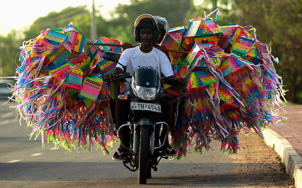 . A man transports lanterns for decorations on his motorbike ahead of Vesak Day celebrations in Colombo May 4, 2012. The festival commemorates the birth and enlightenment of Buddha and his attainment of Nirvana. REUTERS/Dinuka Liyanawatte