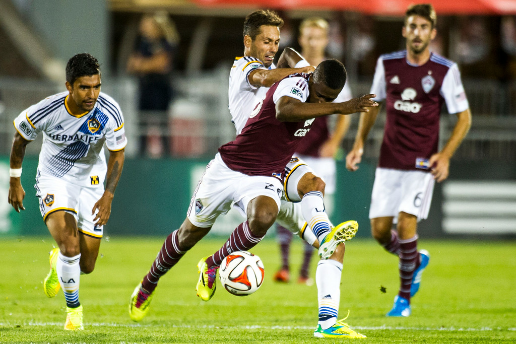 . COMMERCE CITY, CO - AUGUST 20:  Deshorn Brown (26) of Colorado Rapids gets tangled up with Marcelo Sarvas (8) of Los Angeles Galaxy, who was given a yellow card immediately after, during a Major League Soccer game at Dick\'s Sporting Goods Park on Wednesday, August 20, 2014 in Commerce City, Colorado.  Director Comey\'s visit to the Dick\'s Sporting Goods Park is part of his plan to visit all FBI Field Offices in his first year as director.  (Photo by Kent Nishimura/The Denver Post)