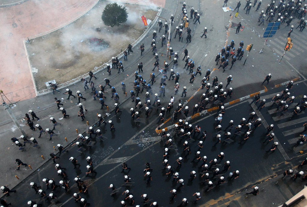 . Police operates during clashes at the Taksim Square in Istanbul Tuesday, June 11, 2013.  (AP Photo/Thanassis Stavrakis)