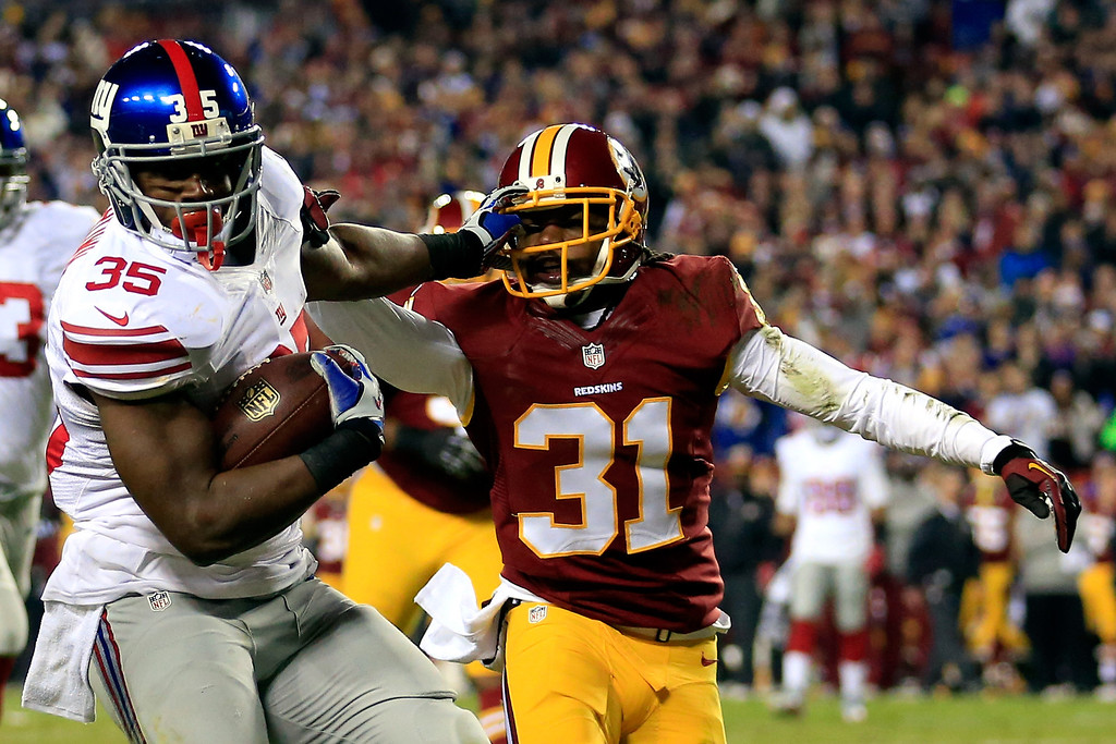 . LANDOVER, MD - DECEMBER 01:  Andre Brown #35 of the New York Giants runs the ball in for a touchdown in the second quarter against Brandon Meriweather #31 of the Washington Redskins during their game at FedExField on December 1, 2013 in Landover, Maryland.  (Photo by Rob Carr/Getty Images)