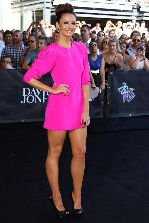 . Ricki-Lee Coulter arrives for the Australian music industry Aria Awards in Sydney, Thursday, Nov. 29, 2012. (AP Photo/Rick Rycroft)