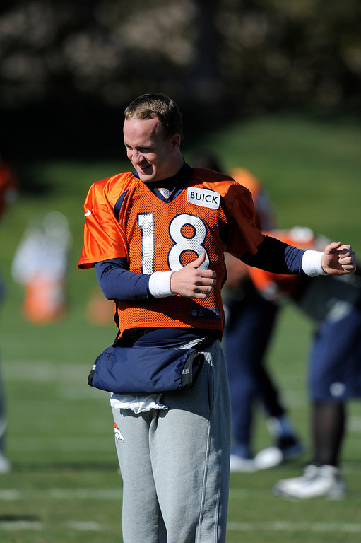 . Denver Broncos quarterback Peyton Manning (18) stretches before practice on October 24, 2013 at Dove Valley. (Photo by John Leyba/The Denver Post)