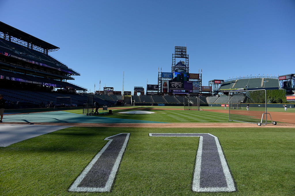 . Todd Helton number was painted on down the third and second baselines in honor of the slugger who will play in his last home game as a member of the Colorado Rockies September 25, 2013 at Coors Field against the Boston Red Sox.  Helton will retire at the end of the season after 17 years with the club. (Photo By John Leyba/The Denver Post)