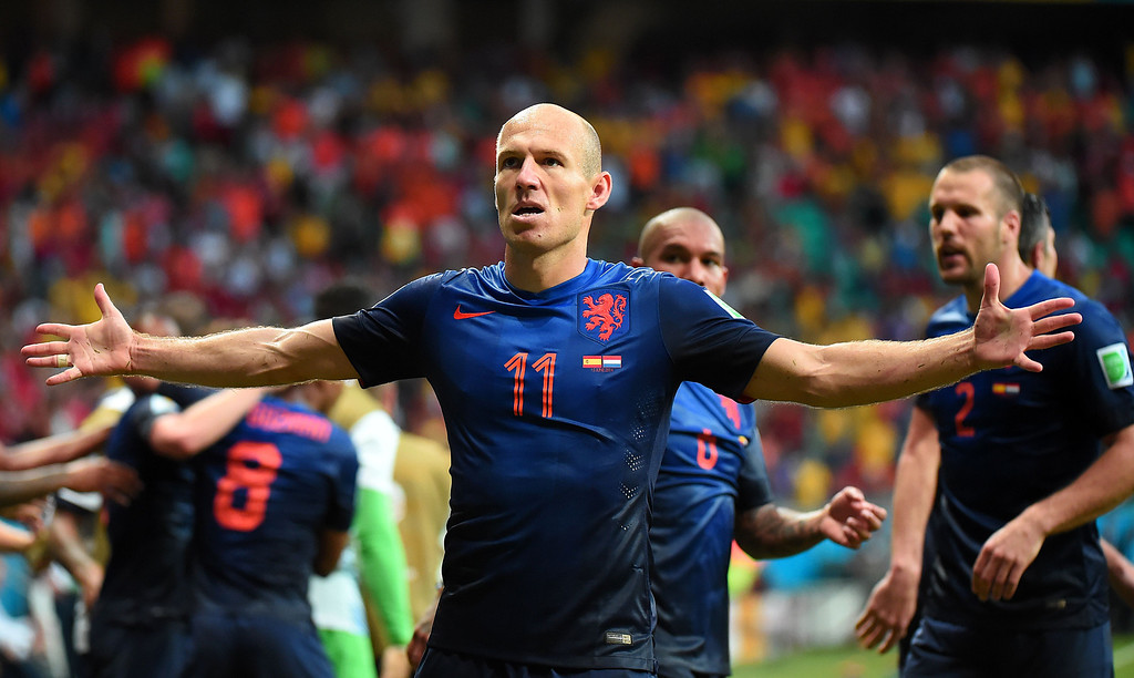 . Netherlands\' forward Arjen Robben (C) celebrates after scoring a goal during a Group B football match between Spain and the Netherlands at the Fonte Nova Arena in Salvador during the 2014 FIFA World Cup on June 13, 2014. DAMIEN MEYER/AFP/Getty Images