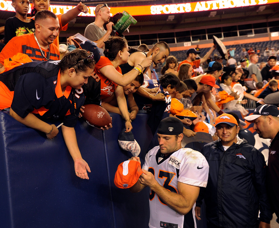 . DENVER, CO. - AUGUST 03: Receiver Wes Welker signed for fans Saturday night. The Denver Broncos signed autographs for fans after practicing in the rain at Sports Authority Field Saturday night, August 3, 2013. Photo By Karl Gehring/The Denver Post