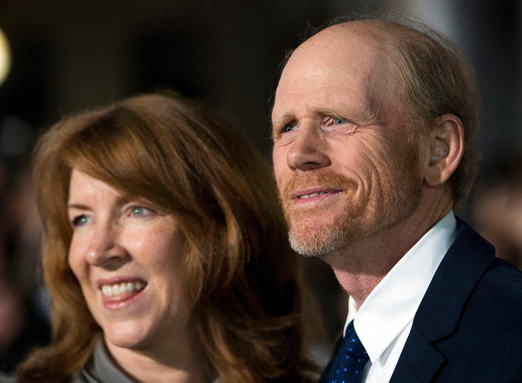 ". Director Ron Howard and his wife Cheryl Howard pose for a photographs on the red carpet at the gala for the new movie ""Rush\"" during the 2013 Toronto International Film Festival in Toronto on Sunday, Sept. 8, 2013. (AP Photo/The Canadian Press, Nathan Denette)"